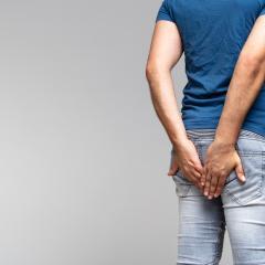 Man holding his bottom