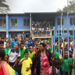 A schoolyard full of students in Papua New Guinea.