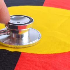 stethoscope on the Australian Aboriginal Flag