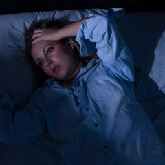 Woman experiencing night sweats