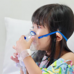 child wearing oxygen mask