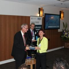 The Royal Australasian College of Physicians president Professor Nick Talley presents News Ltd's Janelle Miles with the M+BS Excellence in Media Engagement Award as Faculty of Medicine and Biomedical Sciences Executive Dean Professor Nick Fisk looks on.