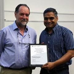 Dr Prasad Chunduri receives his award from Associate Dean (Academic) Geoff Marks.