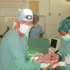 Dr Miller's surgical work for OSSAA in West Timor - cesarean section delivery, 2005