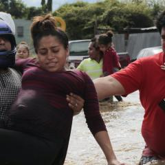 Pregnant mother in flood