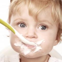 Image of toddler eating yogurt