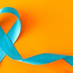 teal ribbon on an orange background
