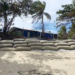 A metre-high wall of sandbags is all that stands between the high tide and the back door of the house, due to rising sea levels.